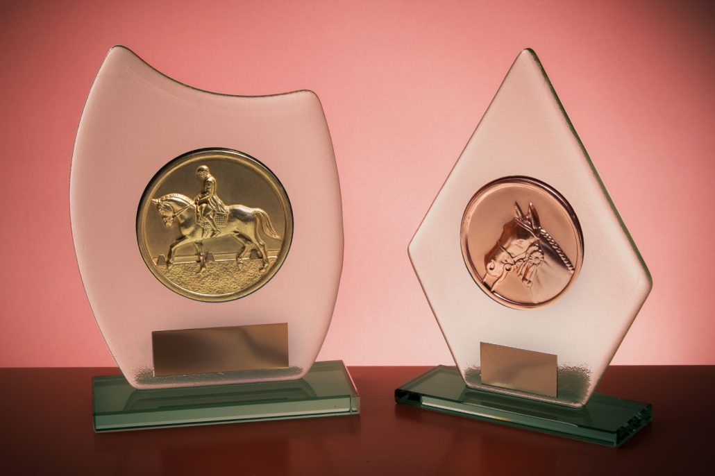 CRYSTAL ECONOMIC TROPHIES WITH BRASS CENTERS